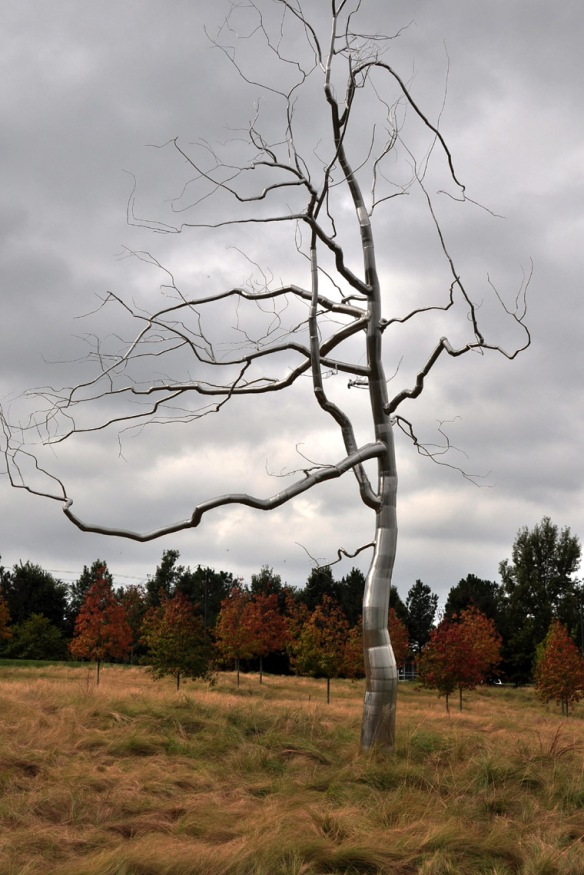 Sculpture Walk at Museum Park, more than 164 acres of open fields and woodlands punctuated by environmental art. Art in Image: A Skew by Roxy Paine