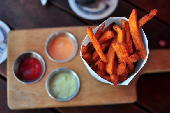 Sharing sweet potato fries at Venice Beach