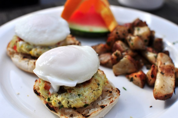 Poached eggs and crab cakes on a muffin