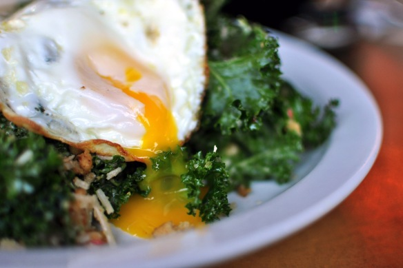 Kale Salad: Chopped kale, fried egg, bread crumbs, toasted pine nuts, lemon garlic chili dressing $9.75