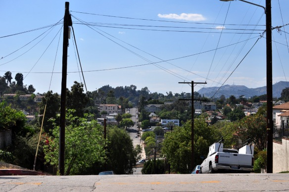 Steep streets with view that look onto the Hollywood sign and Griffith Observatory (right)