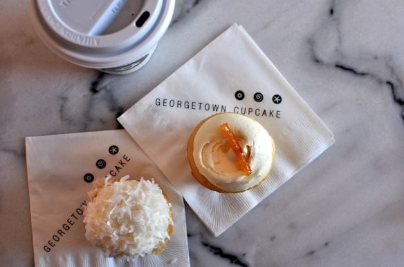 Coconut and Orange Blossom cupcakes, accompanied by an Americano coffee