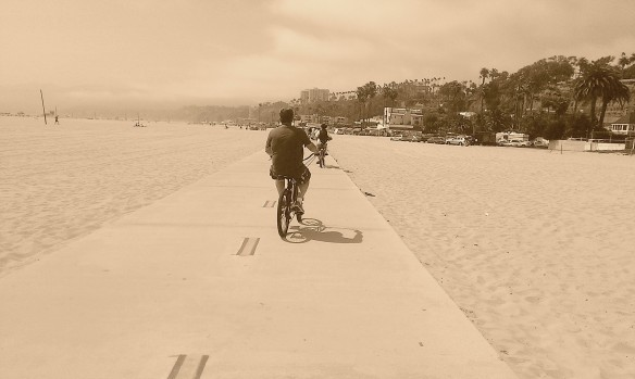 Bike rider in sepia.