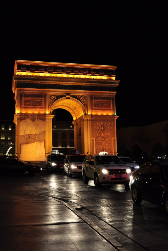 Arc de Triomphe with Gordon Ramsay restaurant advertising