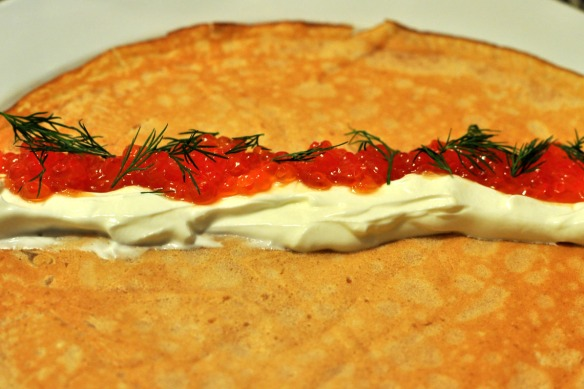 A blinchik with sour cream, caviar, and dill made by my husband
