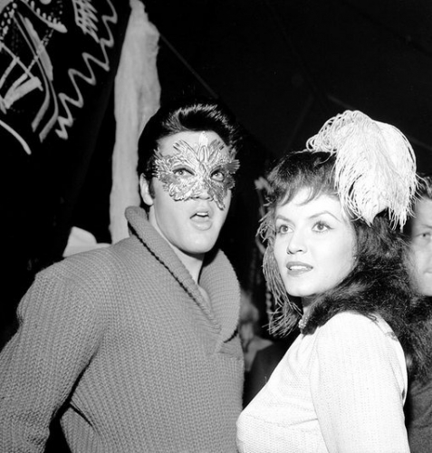 Elvis Presley hides from his fans under a mask with actress Joan Bradshaw in Hollywood on Oct. 31. 1957 / Photo: Michael Ochs Archives/Getty Images). PIN by lulu D.